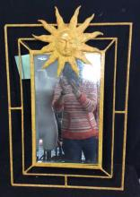 Metal Folk Art Wall Mirror Modern French or Italian mirror with open metal frame and large central folk style sun with face. Yellow painted green and orange speckles. Original tag priced at $650. Measures 30 inches H   20 inches W. Property of a Bedford