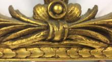 Vintage Carved Gold Leafed Wall Mirror Vintage hanging wall mirror with with gold leaf frame.  Highly ornate decorative accent on top of mirror. Measures 33 inches H x 19.5 inches W. Property of a Scarsdale estate.