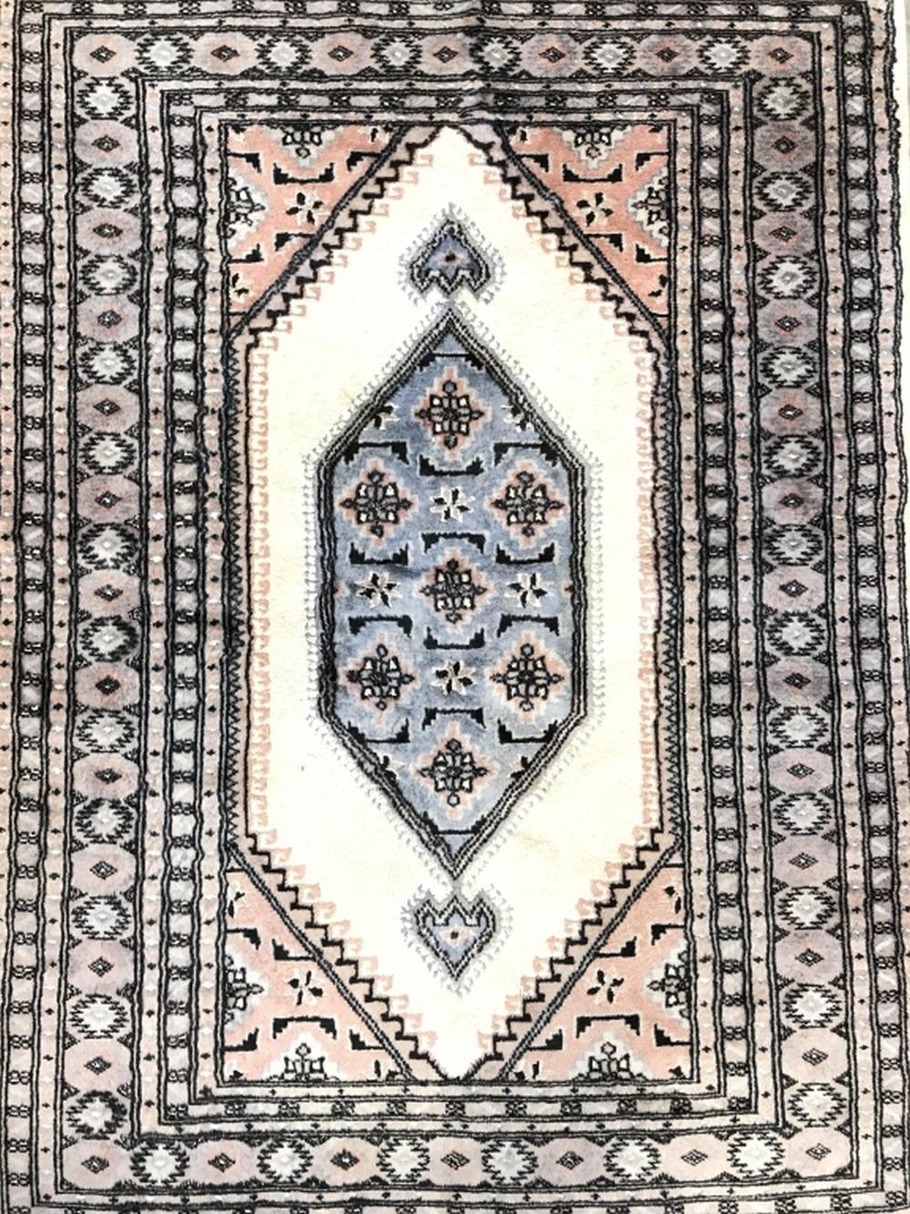 Handmade Multi Toned Wool Rug