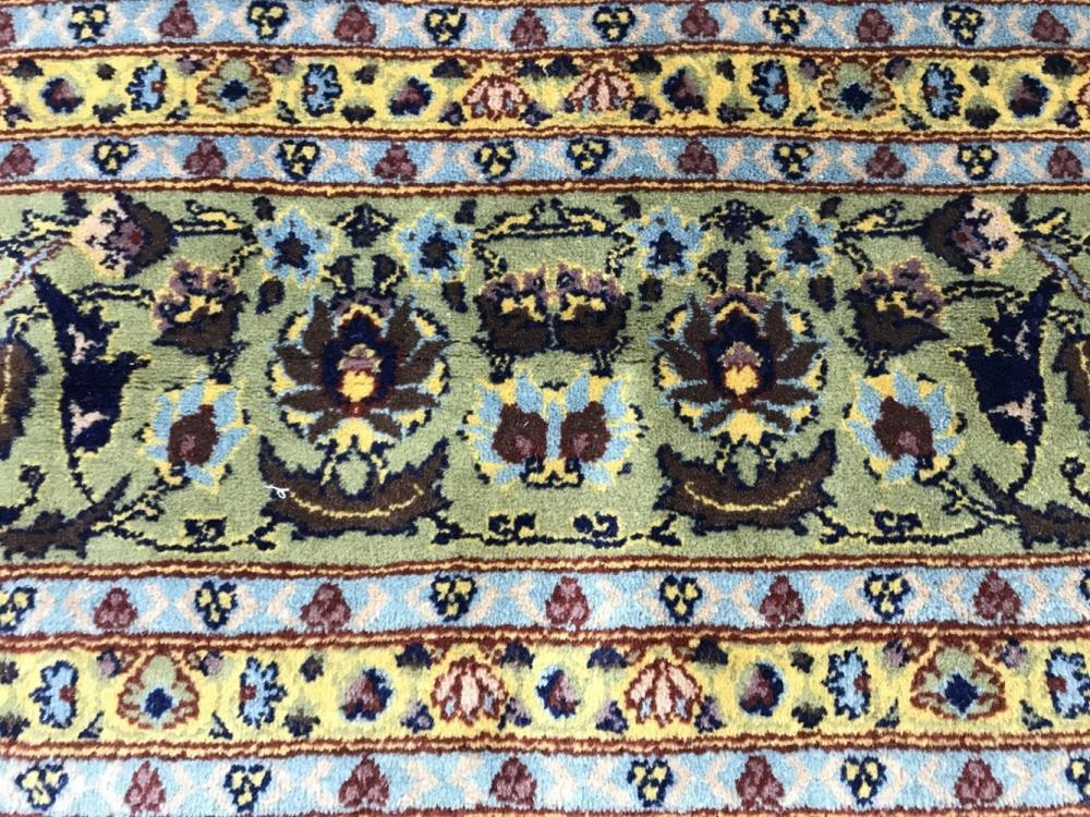 Signed HEREKE Handmade Multi Toned Wool Rug