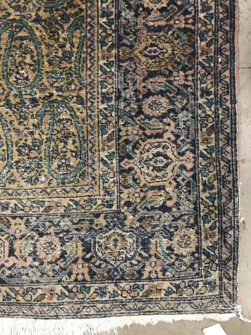 Antique Handmade Floral Detailed Wool Rug