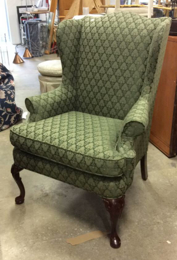 Upholstered green wing chair Show home furniture hours