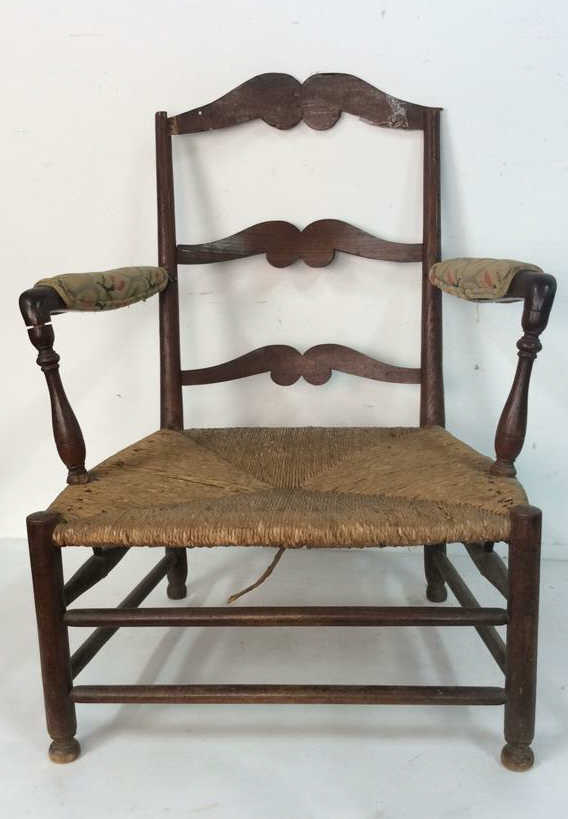 Antique wood rush seat arm chair