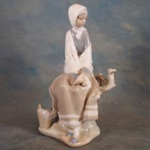 Porcelain Lladro Figure of Woman on Log Bench