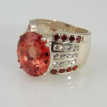 Ring w/9.29ct Oval Cut Spessartite Garnet Center Stone, Approx  0.48ctw Side Garnets, & 0.24ctw White Sapphires in Rhodium over Sterling - Appr $750.00