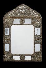 A 17th century Flemish repoussé gilt-brass cushion frame marginal mirror