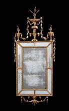 A George III carved giltwood marginal mirror