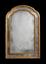 A Louis XVI style carved gilt wood marginal overmantel mirror