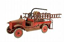 TOY FIRE TRUCK - Circa 1925 Steel Toy with open-front cab, brass bell, rear service body, rear step, wrecking boom, hose reel and ladde