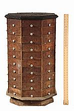 COUNTER TOP HARDWARE STORE CABINET - Octagonal Rotating Eighty-Drawer Oak Frame Cabinet with pine drawers having ceramic knobs, ink sta