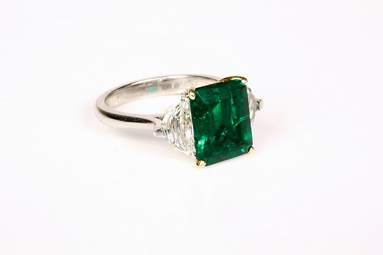 LADY'S RING - Platinum, Emerald and Half Moon Diamond Ring, centered by a 3.87 carat emerald-cut emerald and flanked by half-moon cut