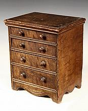 MINIATURE CHEST OF DRAWERS - Early 19th c. Paint Decorated Four-Drawer Child's Dresser with molded top, mushroom knobs, molded front e