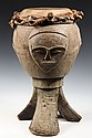 AFRICAN DRUM - Ceremonial Drum,  having three portrait faces set above tripod swept legs, pegged and tied skin head, 21