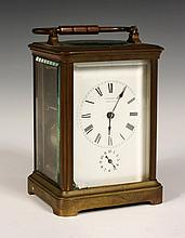 CARRIAGE CLOCK - Early 20th c. Tiffany & Co Brass Repeater Clock with beveled glass sides and top. 5 1/2
