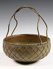 JAPANESE BOWL WITH WIRE HANDLE - Low Raku Bowl in olive glaze, bound in flat brass weaving and having brass woven rim and handle. Unmar