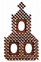 TRAMP ART FRAME - Three-Window Frame in complicated dimensional whittled construction, circa 1900, in mahogany, with leaf carved mats t