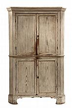 CONTINENTAL CORNER CUPBOARD - Early Pine Cupboard in whitewash, with molded cornice, two sets of recessed panel doors, two upper & one