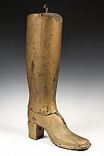 - TRADE SIGN - 19th c. Bootmaker's Sign in full round, carved from pine, in gold paint with single iron loop, old leather reinforcemen