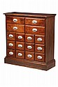 APOTHECARY CABINET - 19th c New England Apothecary Cabinet with four long over twelve short drawers, the ceramic pulls having drug name