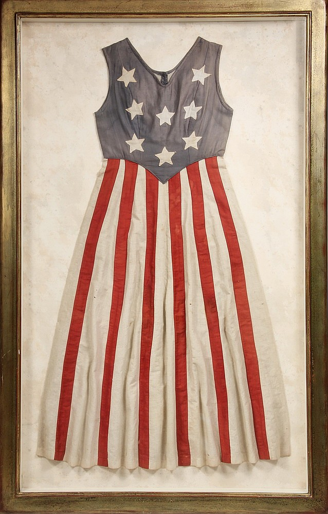 FRAMED DRESS - Circa 1870-80 Centennial made blue top with white applied stars over red and white striped bottom, displayed in a custom