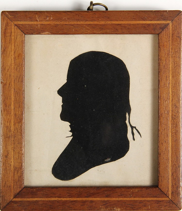 PAPER SILHOUETTE OF A GENTLEMAN - Bearing a striking resemblance to Thomas Jefferson. In an inlaid walnut frame, H. 4 1/2