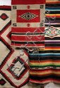 (3) SOUTHWEST AMERICAN RUGS - All 19th c, including Two Navajo Rugs in red, black and oatmeal, 24