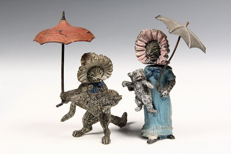 (2) AUSTRIAN BRONZES - Two Cold Painted Figures of Mother Cats carrying Kittens, one in dress, both in bonnets and holding parasols, ca