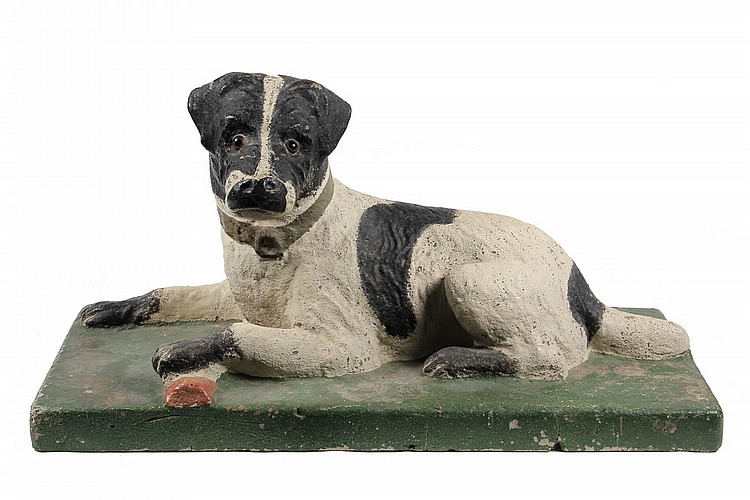 CAST STONE SCULPTURE - Painted Cast Stone Figure of a Reclining Dog with Toy, glass eyes, 27
