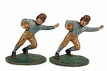 PAIR OF FIGURAL CAST IRON BOOKENDS - Painted Iron 1920s Football Players, in matching positions. 5 3/4