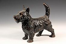 FIGURAL CAST IRON DOORSTOP - Fully Dimensional Standing Scottie Dog in remnants of black paint, unmarked, circa 1910. 10 1/2