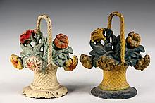 PAIR OF CAST IRON DOORSTOPS - Painted Iron Door Stops in the form of Flower Baskets, same castings, in different paint schemes. Circa 1
