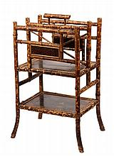 BAMBOO MAGAZINE RACK - Scorched Bamboo Rack with two partitions and lower shelf having chinoiserie lacquer panels, brass fleurette caps