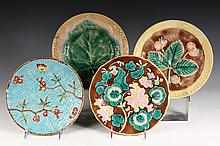 (4) MAJOLICA PLATES - Including: Apple Blossom Plate with blue basketweave; Leaf Plate; Two Different Floral Plates with brown backgrou