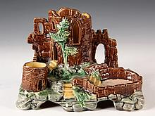 MAJOLICA FIGURAL SMOKING STAND - Continental Porcelain in the form of Castle Ruins, the turrets holding cigars & matches, the pool acti