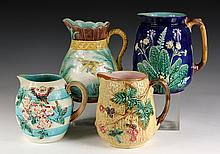 (4) MAJOLICA PITCHERS - Including: Wedgwood Floral Pattern, 8