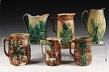 (6) MAJOLICA PITCHERS - Including: Stag Pitcher; Corn Pitcher; Apple Blossom & Log; Etruscan Fern by Griffin, Smith & Hill; Fern on Fen
