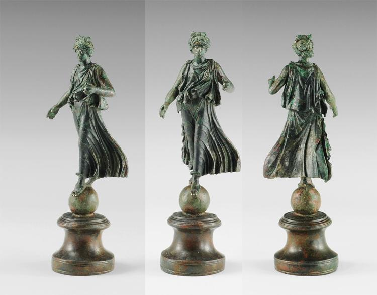 Roman Luna on Globe Statuette