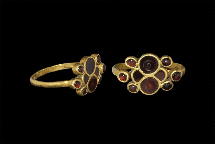 Gothic Gold and Garnet Ring with Hidden Faces