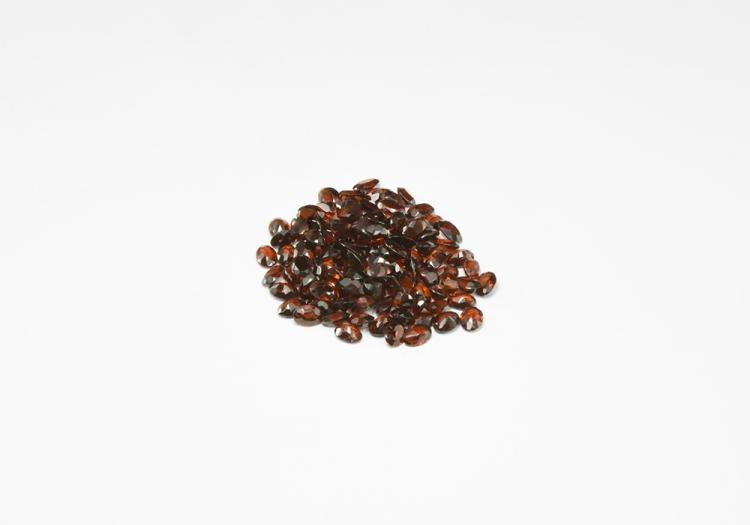 Natural History - 98.5 Carats of Garnet Oval-Cut Gemstones.