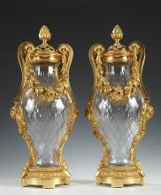 A Pair of Baccarat Crystal and Gilded Bronze Amphora Shaped Vases
