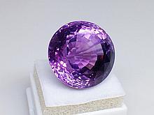 29.20 carat round cut fine amethyst
