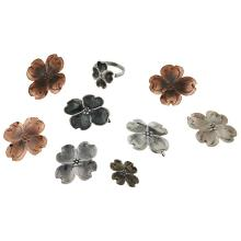 Stuart Nye Dogwood jewelry group: six (6) pendant drops, a ring and a pair of earclips earclips: 1