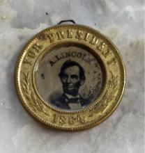 Rare Abraham Lincoln 1864 campaign button. Ferrotype portraits of Lincoln and Johnson. Losses to portraits present. Approximately 1-inch diameter.