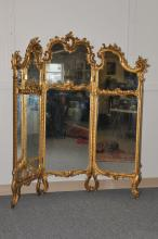 A 19th century French style carved and gilt wood three part dressing screen. Leaf and scroll decoration. Short cabriole legs. Fabric back. Missing pieces of decoration. 62