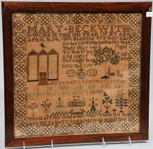 1809 Needlework Sampler wrought by Mary Beckwith. Geometric borders. The field with alphabet and verse. Decorated with houses, birds and flowers. Framed. Overall size: 19-1/2