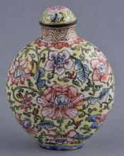Snuff bottle. China. Ch'ien Lung mark (1735-1796) and period. Decoration of stylized mallow flowers on a pale yellow ground. 2-3/4