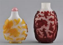 Lot of two Snuff Bottles. China. 19th century. A ruby cut to snowflake with figures and pine trees and a yellow cut to white with goldfish. 3