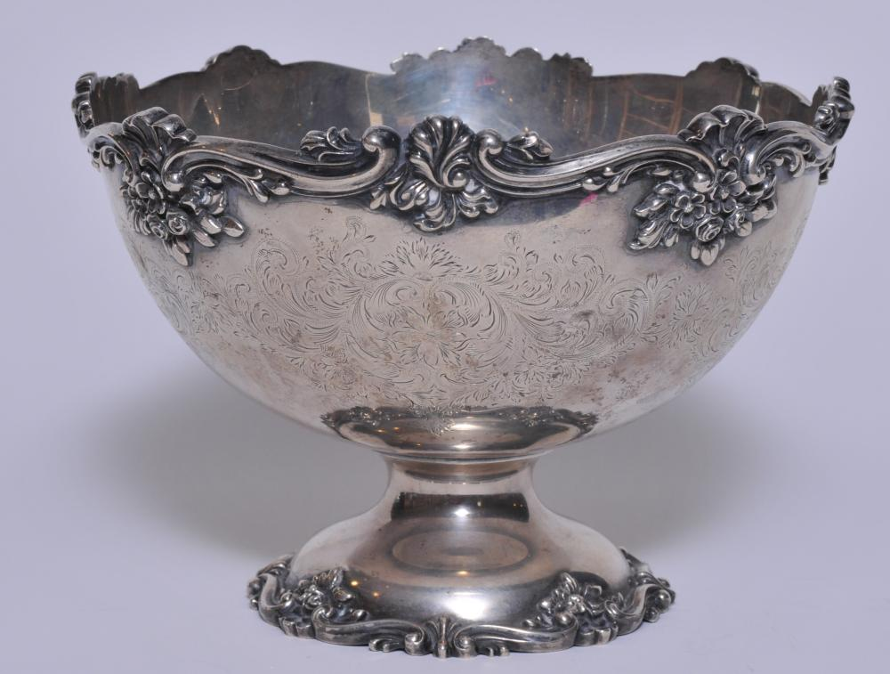 """Durgin sterling silver large ornate footed bowl. Engraved floral scroll decorated body. Applied floral scroll top rim and base. 9"""" diameter. 6-1/2"""" high. Interior with a slight crease dent coming through from the base. Light scratches. 32.8 ozt."""
