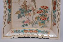 """Lot 4: Large Japanese 19th century Satsuma earthenware pottery tray with bird on a branch decoration. Chrysanthemum flower borders. Impressed circle mark on back. Chip on one corner. 15-1/2"""" x 12-1/2""""."""