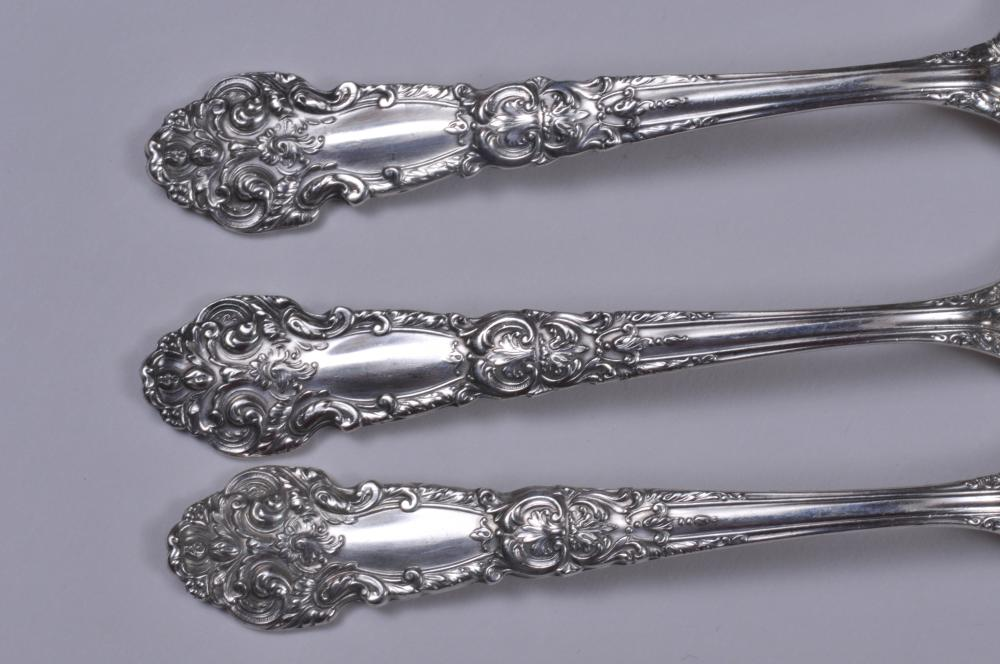 """Lot 7: Reed and Barton sterling silver """"French Renaissance"""" pattern 72 piece flatware set. Includes: (12) forks- 7-1/4"""". (12) salad forks- 6-1/8"""". ( 12) teaspoons- 6"""" ( 12) cream soup spoons- 5-3/4"""". ( 12) solid butter knives- 6"""". (12) knives- 9-1/4"""". 12"""